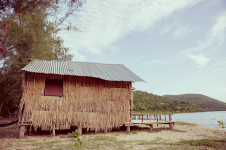 thatched cottage: thatched cottage at the beach near mangrove forest Stock Photo