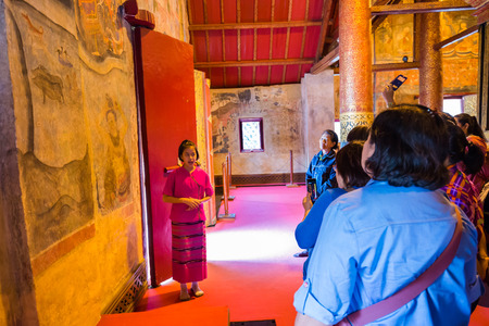 min: NAN , THAILAND - MARCH 4, 2016 : A girl working as a tourist guide in Wat Pu Min, Buddhist Temple and Historic Site National Nan, northern of Thailand on March 4,2016