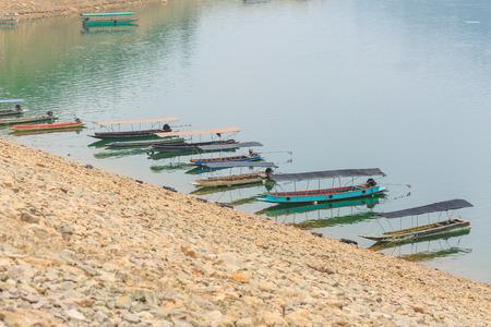 confine: NAKHON NAYOK, THAILAND - APRIL 1,2016 : Small boats along the River at Prakarnchon Khun Dan Dam early in the morning in Nakhon Nayok, Thailand on April 1 , 2016 Editorial