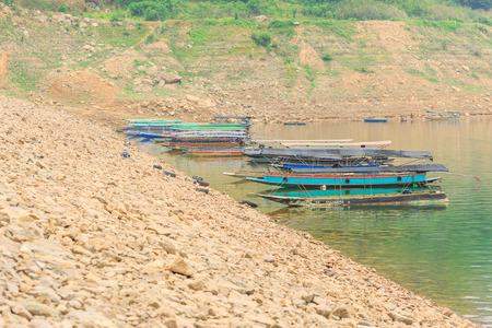 confine: NAKHON NAYOK, THAILAND - APRIL 16,2016 : Small boats along the River at Prakarnchon Khun Dan Dam early in the morning in Nakhon Nayok, Thailand on April 16 , 2016 Stock Photo