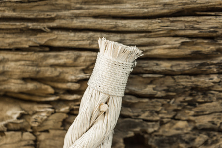 tack: White rope with tack on old wood
