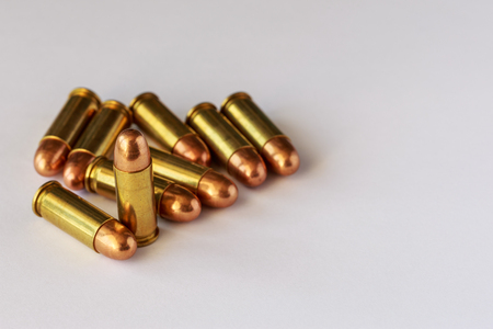 9mm ammo: bullets on white paper Stock Photo
