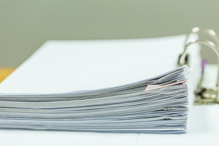 Stack of business report paper files