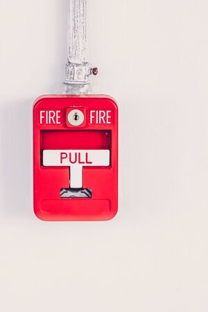 sprinkler alarm: Old red box fire alarm  isolated on white background