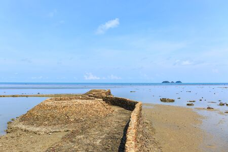 chang: small stone wall by the sea , Koh Chang , Thailand Stock Photo