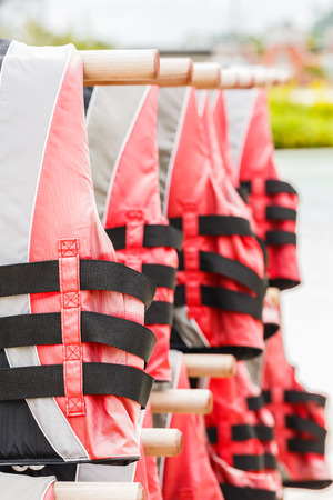 Close up life preserver floating jacket near water pool
