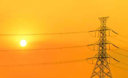 electric grid: high voltage post.High-voltage tower in sunset time