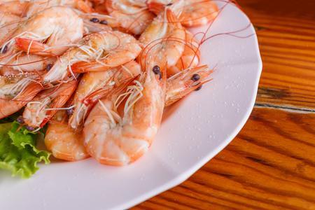 Baked butter shrimp on white dish