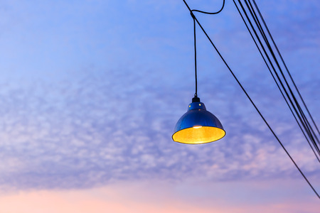 power cables: Lamp and power cables on the sky in the evening Stock Photo
