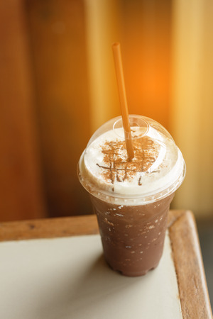 creamed: Iced cocoa glass with Straw at sunlight