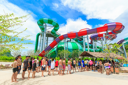 lining up: PATTAYA, THAILAND - SEPTEMBER 30, 2016: Many tourists are lining up for playing  the RamaYana Water Park. The Park is built to the highest international standards and using premium equipment. Editorial