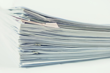 clerical: Stack of business report paper files