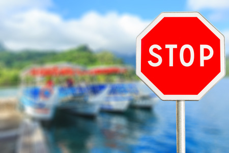 Red Stop sign on boat blurred background