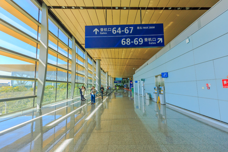 get ready: KUNMING, CHINA - DECEMBER 10, 2016: Detail of interior of kunming changshui airport where passengers get ready for their departures