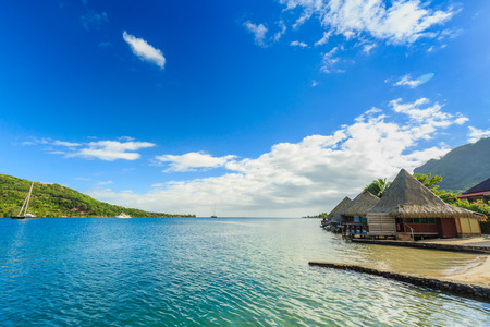 PAPEETE, FRENCH POLYNESIA - APRIL 14 , 2017: The Beautiful sea , resort and sailing  boats in Moorea Island at Tahiti PAPEETE, FRENCH POLYNESIA.