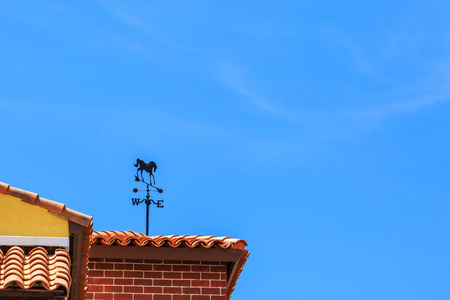 The winds direction on roof in sunshine day on blue sky Stock Photo