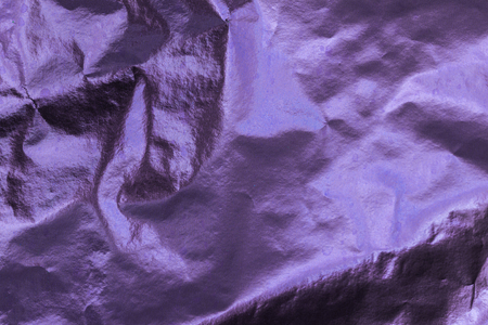 creased: Closeup of purple  wrinkled paper texture background