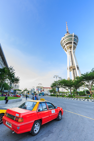 PERLIS, MALAYSIA - JULY 24, 2017: Taxi and Alor Setar Tower in Alor Setar with the cloud and the blue sky in Kedah, Malaysia.