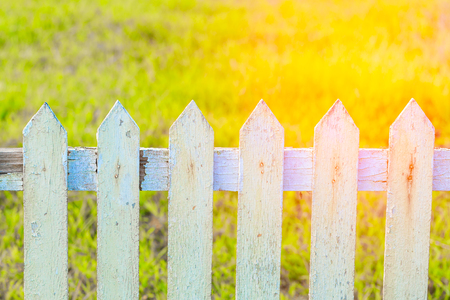 Close up old white fence in garden with sunrise Stock Photo