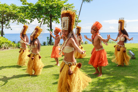 PAPEETE, FRENCH POLYNESIA - AUGUST 28, 2017: Polynesian women perform traditional dance in Tahiti Papeete, French Polynesia. Polynesian dances are major tourist attraction of luxury resorts of French Polynesia. Editorial
