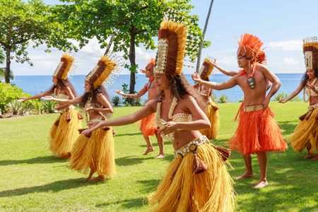 PAPEETE, FRENCH POLYNESIA - AUGUST 28, 2017: Polynesian women perform traditional dance in Tahiti Papeete, French Polynesia. Polynesian dances are major tourist attraction of luxury resorts of French Polynesia.