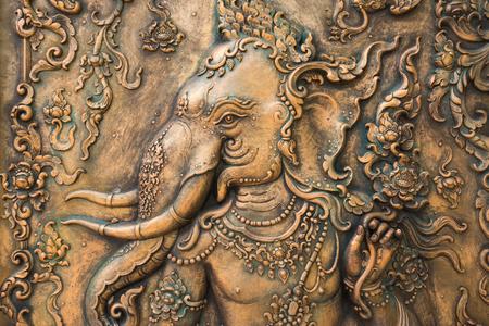 A bronze statuette of Ganesha.