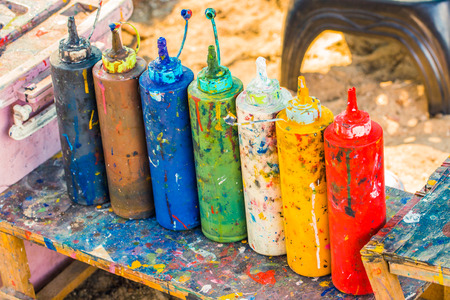 Paint bottles to be squeezed for art and craft education background Stock Photo
