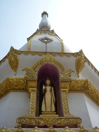 standing buddha in the tample thailand Stock Photo