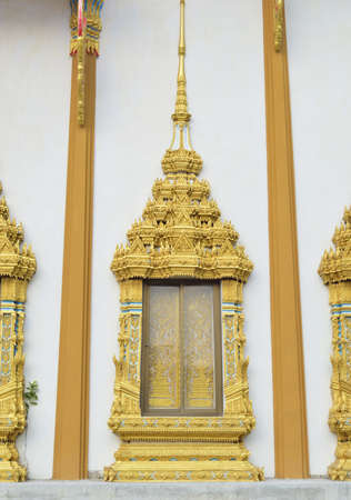 Ancient Golden carving  window of Thai temple