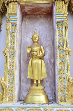 Buddha Image in standing in thai tample
