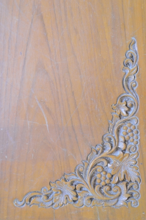 Triangle thai art Grapes Carving on wood photo