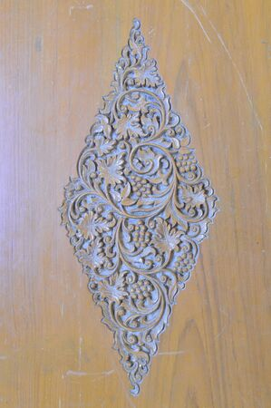 Square thai art Grapes Carving on wood photo