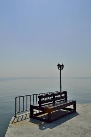 unattached: Bench by the sea