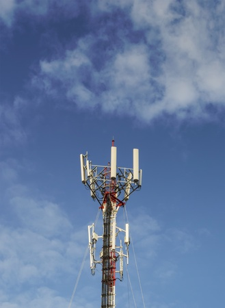 Red and White Telecommunication tower with blue sky and cloud  photo