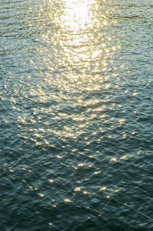 sea water with sun reflections photo
