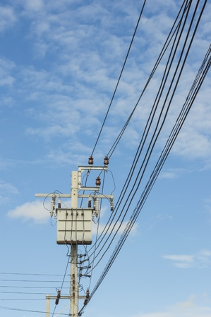 Transformer on Electricity post, high power station. High voltage with blue sky Stock Photo - 21832973