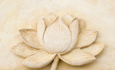 Carving Clay of lotus flower on wall photo