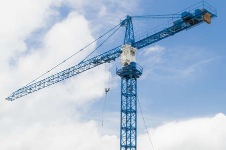 Construction crane with blue sky and cloud photo