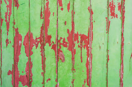 Weathered Old Peeling Paint  green and red wooden wall  photo