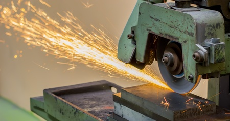 grinding machine on work and spark Stock Photo - 22027459