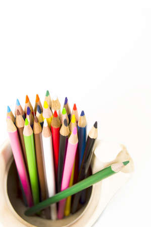 color pencils in Pitcher isolate white background photo