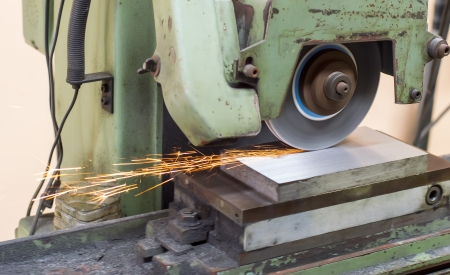 grinding machine on work and spark photo