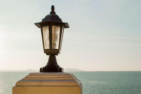 close up lamp post and sea Stock Photo - 22435791