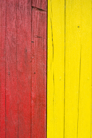 louver boards: plank wall painted with red, yellow  color paint