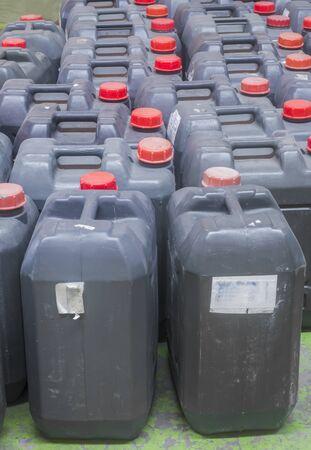 contain: used black plastic gallon Contain Liquor for machanic industry