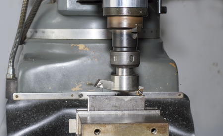 milling machine working in minifactory photo