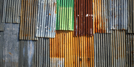 old rusty corrugated metal sheet wall as background
