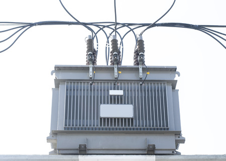 Transformer on Electricity post, high power station. High voltage  photo