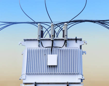 Transformer on Electricity post, high power station  High voltage with blue sky Stock Photo - 27119475