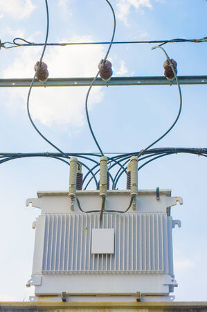 Transformer on Electricity post, high power station  High voltage with blue sky and clound Stock Photo - 27119476